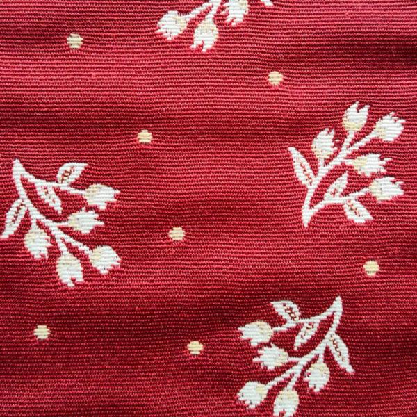 Mitteldecke Zweige Creme mit rotem Hintergrund Stoff