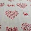Stoff Hirsch rot mit Herzen - Hintergrund creme